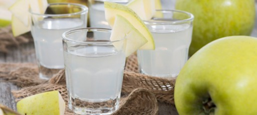 Shots of Apple Liqueur on vintage background